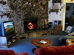 Family TV Room with fireplace for our winter guest. Bring your own firewood.