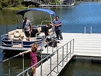 A guest family enjoying our dock for their new Pontoon Boat