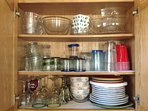 Lot's of glassware, wine glasses, bowls, serving platters, plates and more provided.