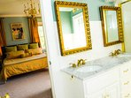 Honey Room bathroom has marble sinks, shower and large bathtub. Kohler fixtures.