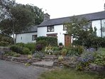 Broadhaven Cottage has its own private entrance and is attached on the left of our house