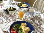 Greens from our gardens and eggs are served for those guests that are not vegan..