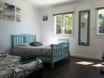 Chambre en rez de chaussée avec deux lits en 140