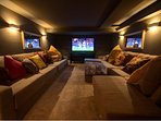 An amazing media room in the basement, 65' curved Ultra HD TV with Sky