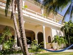 A view of the front of the building. Don´t you want to be in that hammock!?