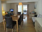 The open plan living and dining area is tastefully decorated