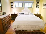 Guest room on the 2nd floor with queen size bed, dresser, closet, chair and shared bathroom