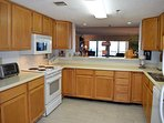 Huge kitchen area, has a washer and dryer are in a small room off kitchen.