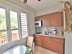 kitchen with two burners, microwave oven, BBQ at the balcony