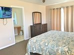 Master bedroom with ensuite and a TV