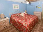 Master bedroom with ceiling fan and nightstand with landline phone