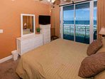 Master bedroom with flat screen TV and private Gulf-front balcony access