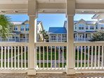Balcony,Railing,Building,Fence,Palm Tree