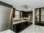 Incredible custom designed high end kitchen with space saving built in china cabinet.