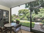 Enjoy dining al fresco on your private screened lanai overlooking water feature that surrounds island w/pool...