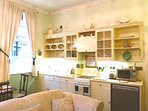 Pretty Kitchen in open plan period living room.