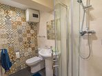 Main bathroom with shower, WC And WHB.