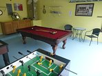 Foosball, pool table with table and chairs