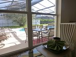 Breakfast nook looking out to the pool area