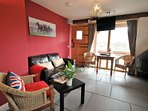 Lounge/dining area with woodburner