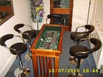 Games table. Doubles as hall side table when the wooden top is replaced. Chairs from the kitchen.
