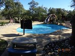 Beautiful pool w/waterslide, basketball hoop and picnic area