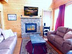 Den: Leather Furniture, Gas Fire Place, 50' TV, all wood construction for a cabin look and feel.