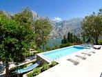 sun lounge, pool and hammock areas