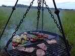 Honeyed gammon, roasted veg and new potatoes cooked over your firepit on a grill & hotplate.