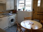 Well stocked Kitchen/Diner, electric hob, gas oven, fold up table. Plenty of crockery cafetiere etc.