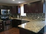 Beautiful New Kitchen with granite counter tops and New appliances