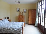 Light and airy ground floor double room with doors leading to the garden