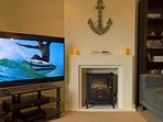Home cinema system and fireplace