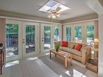 The lovely sun room is the perfect place to curl up with a new read.
