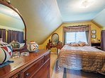The masted bedroom houses a cloud-like queen!