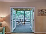 Large french doors lead out to a marvelous screened-in patio.