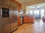 Stainless steel appliances make up the fully equipped kitchen.