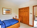 Two guests can stay in this room with a twin bed and a twin trundle bed.