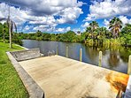 Water access is just beyond the yard of this Cape Coral vacation rental house!