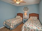 The second bedroom offers 2 twin-sized beds.