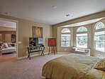 The master bedroom offers a queen bed and great outdoor views.