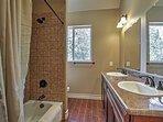 This bathroom features double vanities.