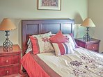 The second bedroom boasts a queen-sized bed.