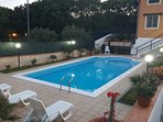 private swimming pool, equipped with deck chairs and umbrellas