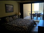 Master bedroom with king size bed, view and access to large balcony