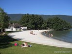 St Jorioz beach with beach restaurant.  Lots of shade under the tress, volley ball & boules pitch.
