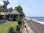 Uninterrupted ocean views and beach just meters away.