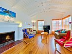 Classic high beam ceilings and fireplace make the living area open and breezy, couch is a sleeper sofa. Beautiful...