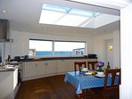 kitchen/diner with roof lantern and panoramic sea view