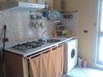 zona cottura e lavatrice